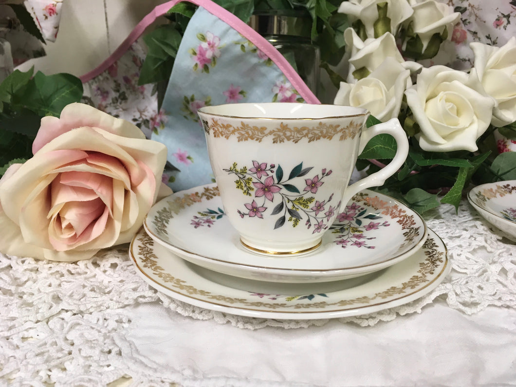 Royal Grafton, spring flowers, floral and gold tea cup trio set. c.1957