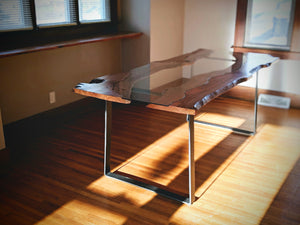 This gorgeous Cherry Fault Line Table is handmade right here in Grand Rapids Michigan and includes the optional custom cut glass that follows the unique curves of the live edge slabs.