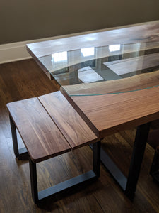 This gorgeous Fault Line Table is handmade right here in Grand Rapids Michigan and includes the optional custom cut glass that follows the unique curves of the live edge slabs. It also has a matching set of four Fault Line Benches.