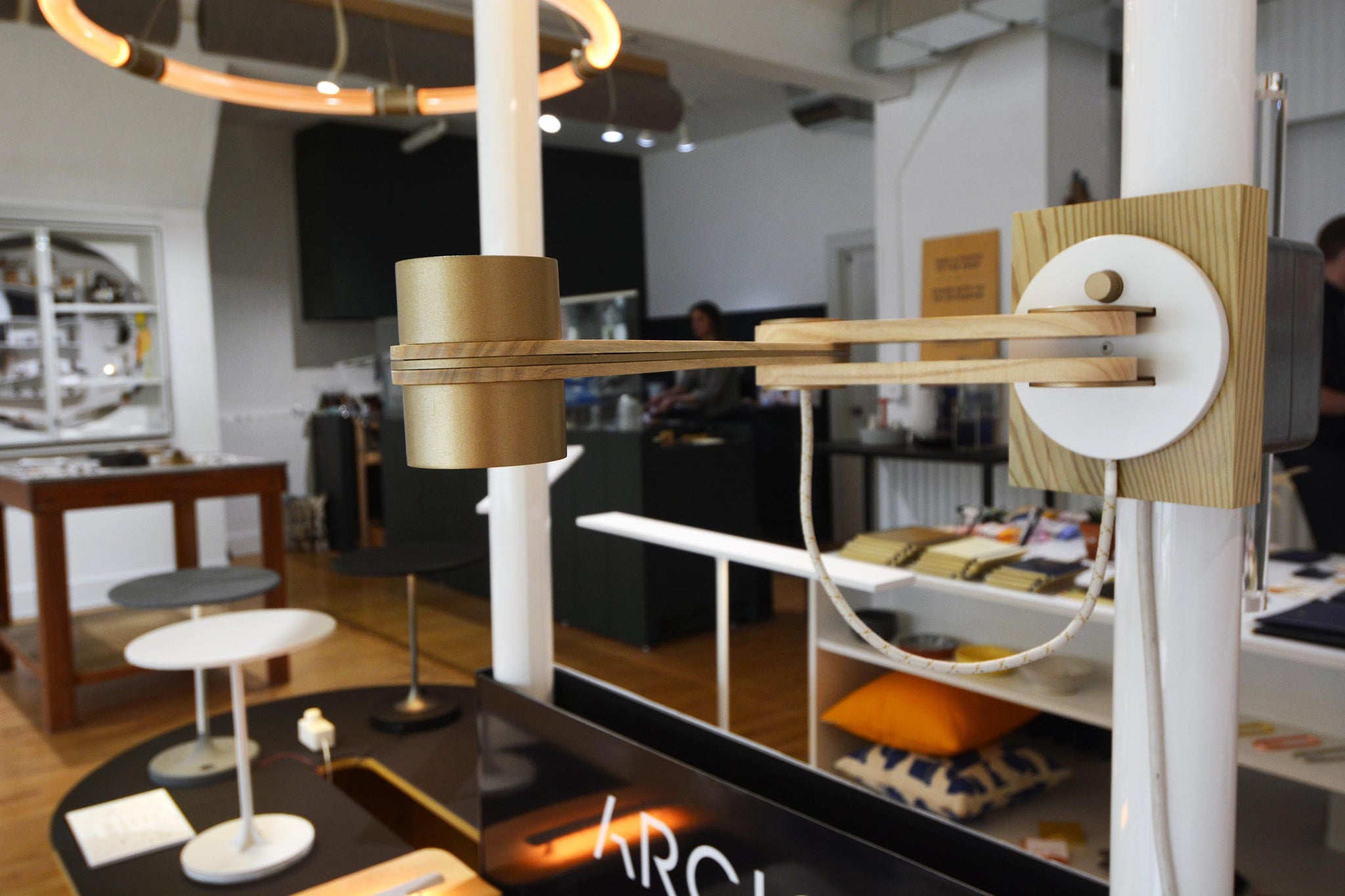 Arcio lighting shows off new wooden sconce prototype.