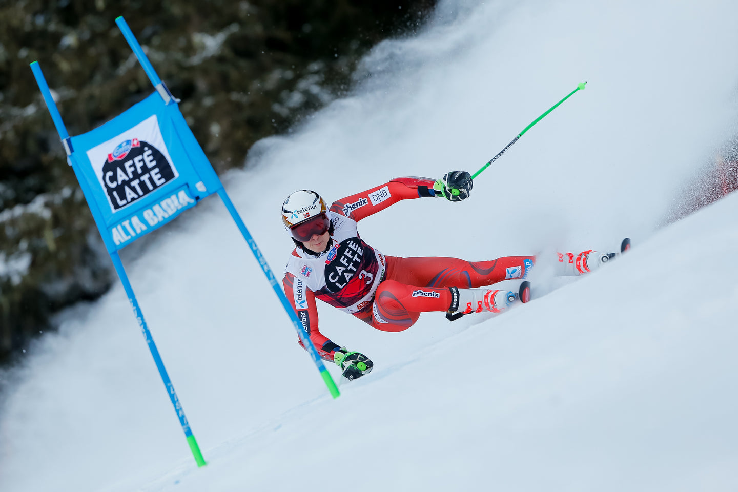 ski racer leaning into a GS turn | buy your ski race gear online at race room skis
