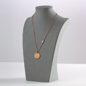 Grace Cross Disc Necklace on Display