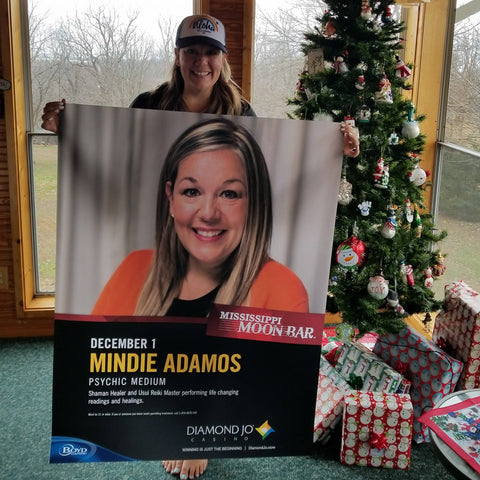 Mindie Adamos with psychic readings sign