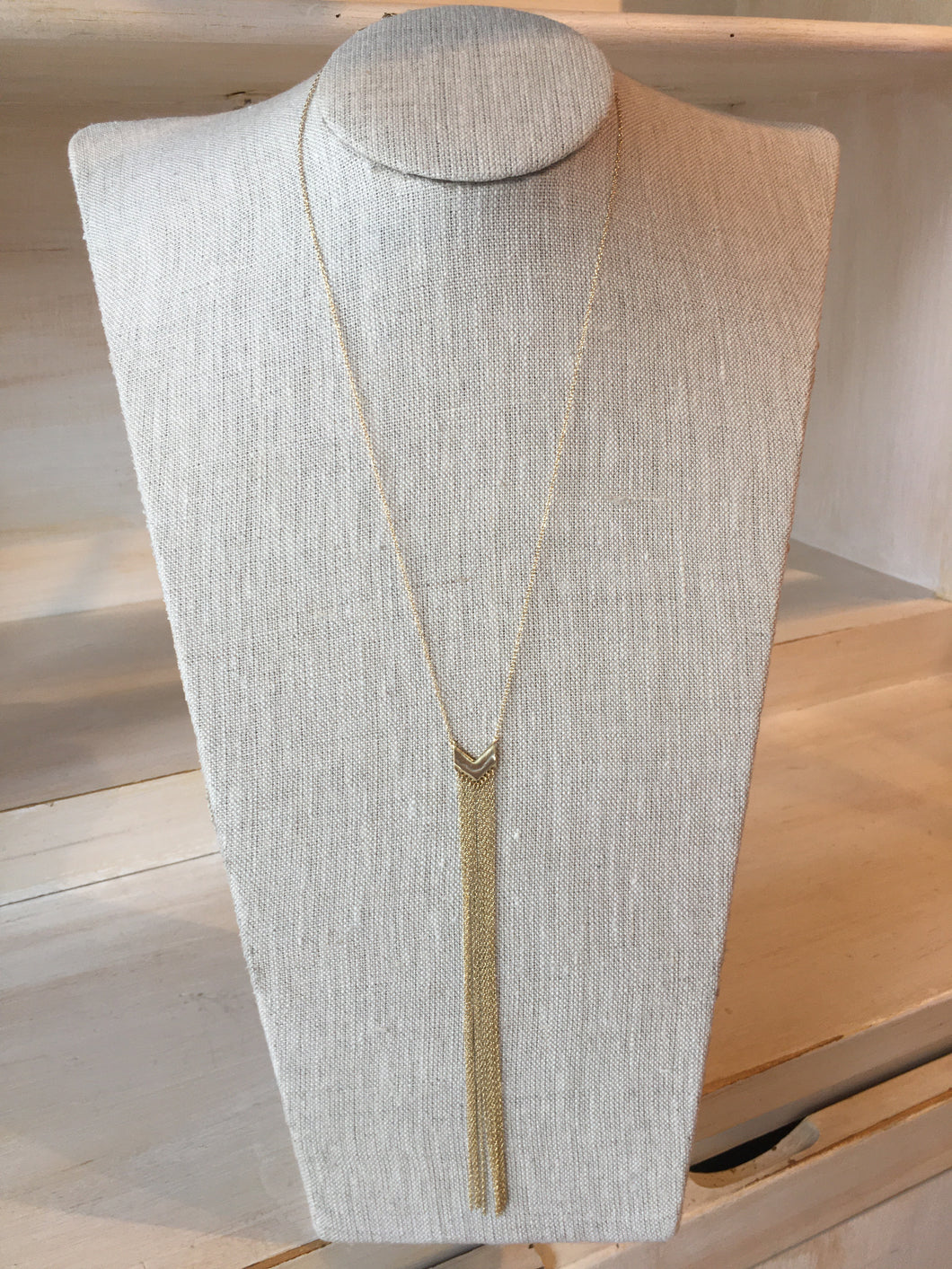 Gold long tassle necklace.