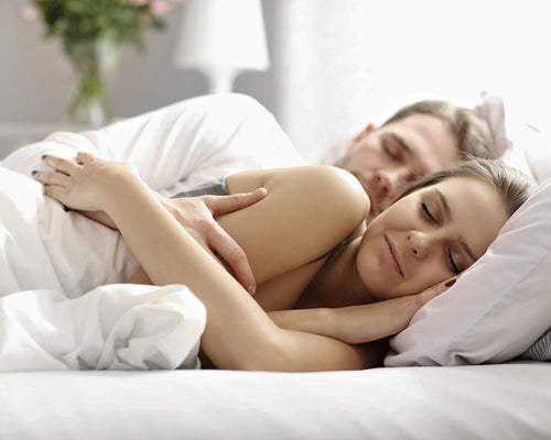 A couple sleepng comfortably on Origanami Organic Cotton Percale Sheet s, Color Cloud (True White)
