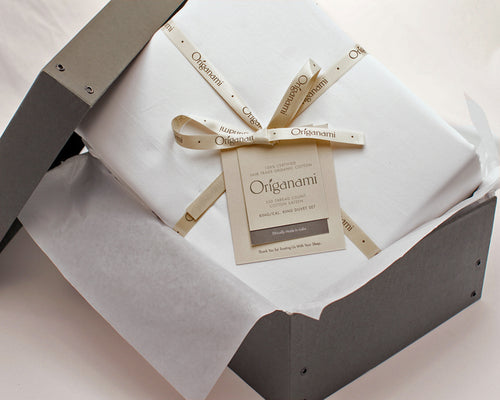 The Origanami Organic Cotton Percale Sheet Set, Color Cloud (True White) In Its Sustainably Responsible Storage Box