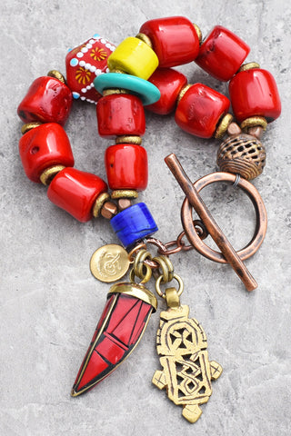 Bold Red Bamboo Coral, African Brass Cross and Tibetan Horn Charm Bracelet $175
