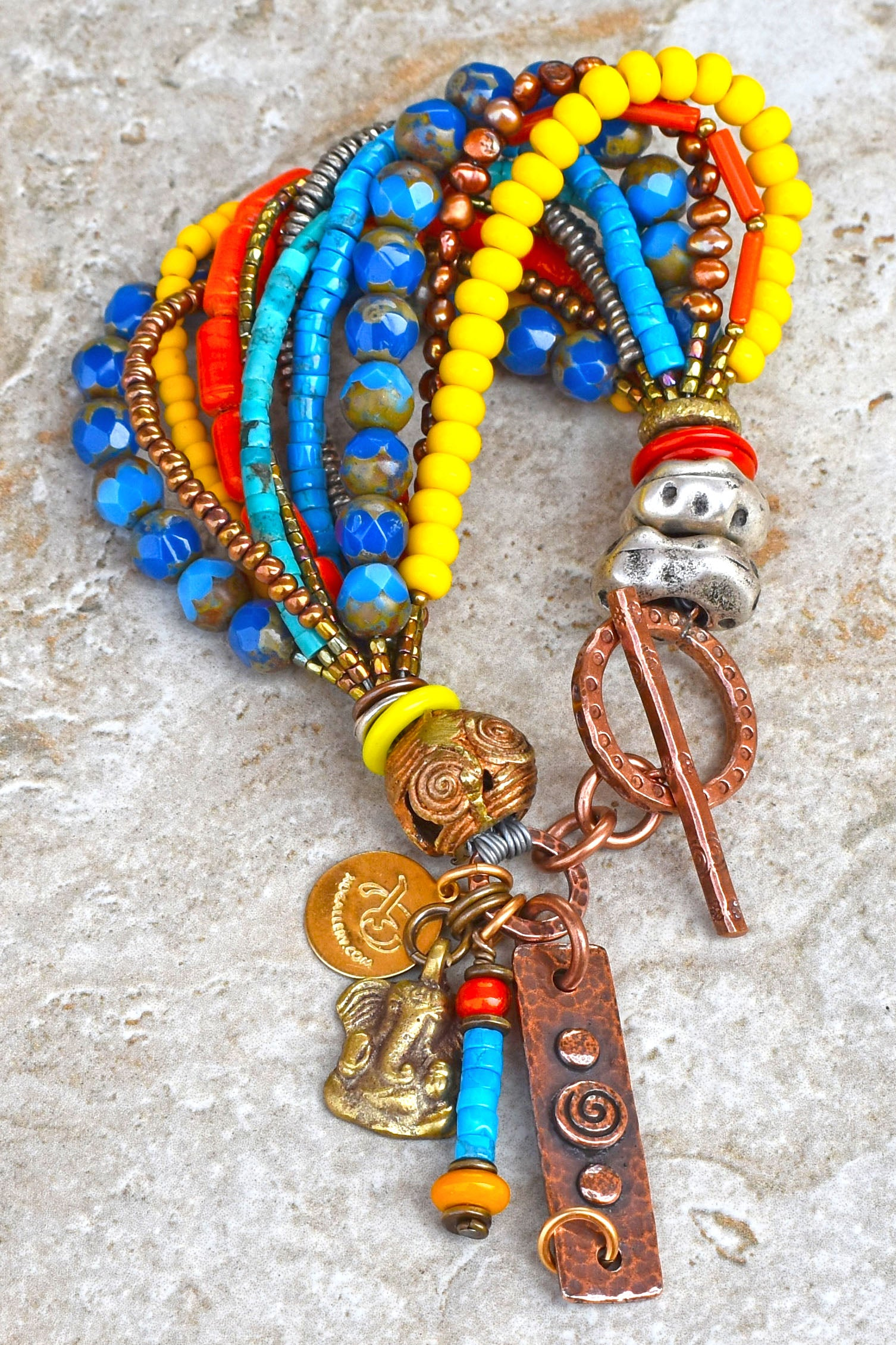 Colorful and Soulful Blue, Orange and Yellow Olympian Charm Bracelet $175