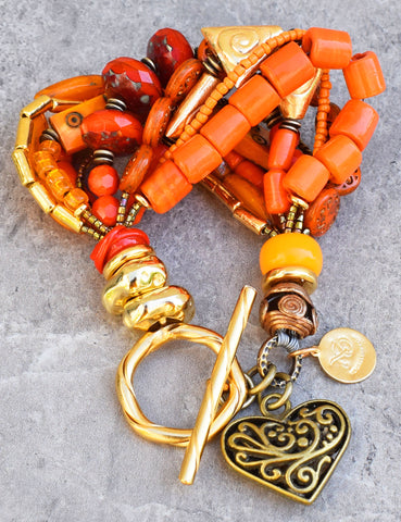 Beautiful, bold and vivid orange mixed media heart charm bracelet