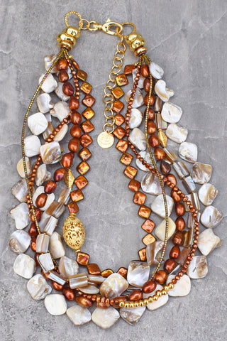 https://www.xogallery.com/collections/white/products/stunning-champagne-pearl-gold-and-bronze-statement-necklace?variant=6421925986331
