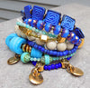 beautiful cobalt and turquoise gold coin and Greek key tassel bracelet