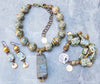 gorgeous green rhyolite stones and gold statement jewelry