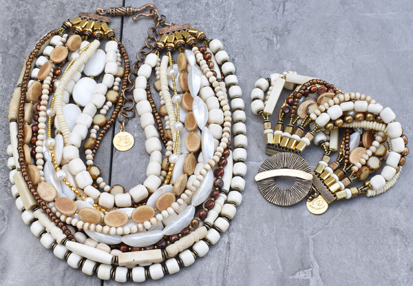 gorgeous ivory, bone, pearl, shell, and gold winter white statement necklace and bracelet