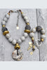 exotic gray, black and gold statement jewelry