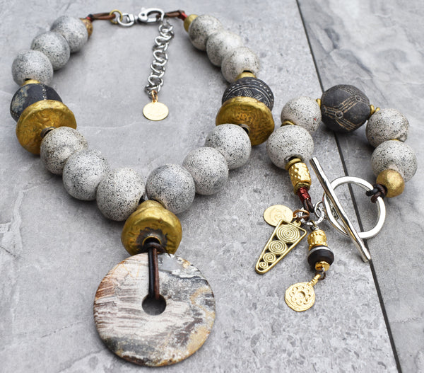 rustic gray glass, black Mali clay, Tibetan gold and African brass jewelry