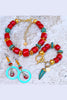 gorgeous red bamboo coral, turquoise and gold statement jewelry