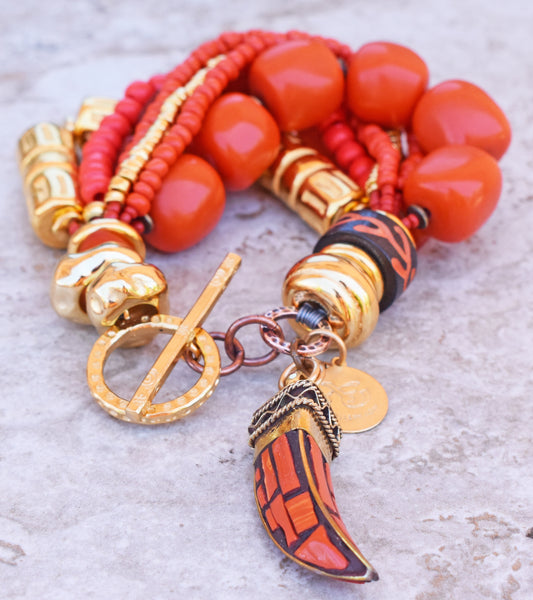 Vibrant and Brilliant Orange Coral and Exotic Gold Tusk Charm Bracelet