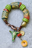 Rustic African Tribal Green Orange Krobo Bead Cow Skull Charm Bracelet
