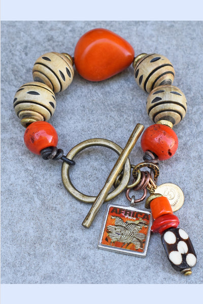 African Inspired Vibrant Orange, Carved Horn and Zebra Charm Bracelet