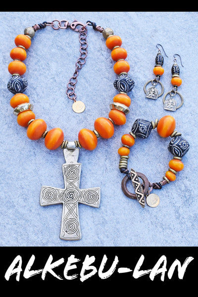 ethnic and exotic African-inspired copal amber resin, Ethiopian Coptic cross, Mali Clay and African brass jewelry