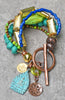 Vibrant Green Turquoise, Blue Moroccan Clay and Buddha Charm Bracelet