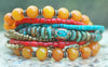 Tibetan-Inspired Turquoise, Amber, Red and Bronze Boho Charm Bracelet