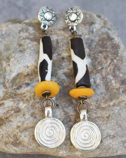 giraffe print, amber orange bone and silver spiral dangle earrings