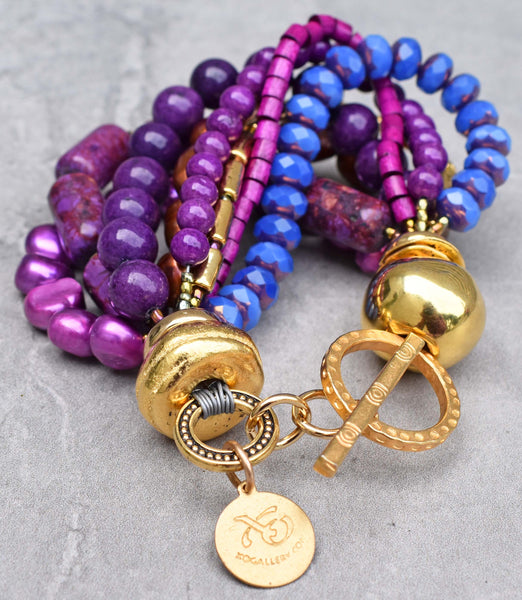 Gorgeous and vibrant purple, magenta, periwinkle and gold statement bracelet