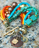 Desert-Inspired Copper, Gold, Orange & Blue Glass Charm Bracelet