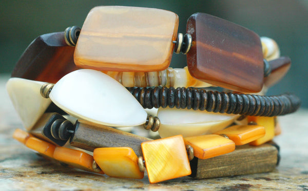 Natural and Organic Amber Horn, Shell, Bone and Brass Charm Bracelet