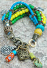 bohemian charm bracelet with blue, green and yellow beads
