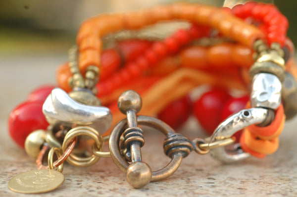 Mixed Media Orange Glass, Silk, Clay and Metal Multi-Strand Bracelet