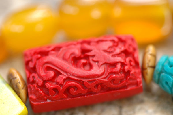 stunning dragon carved cinnabar puff rectangle bead