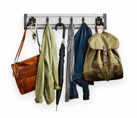 An Entryway GearTrack® Pack hanging a variety of coats, bags and accessories.