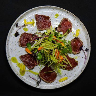 Cured venison tataki, with smoked apple and leek slaw
