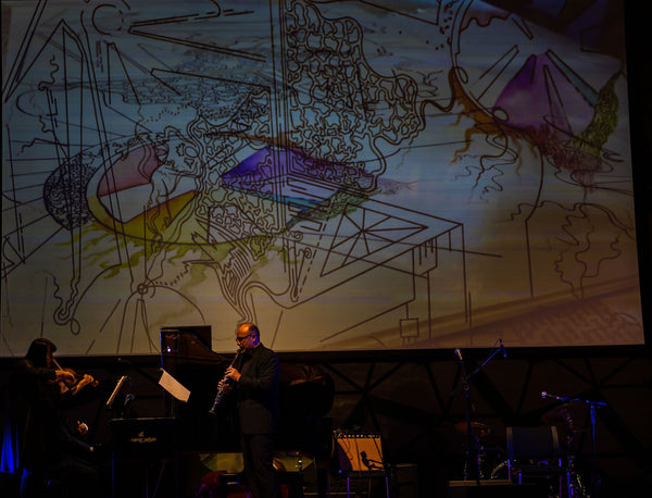rVb's artwork being projected behind Plexus at the Women in Music Festival 2019