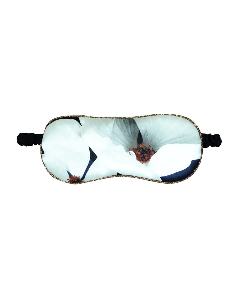 Reversible silk sleep mask from Violet & Wren has an oversized magnolia print on one side and a classic stripe print on the other