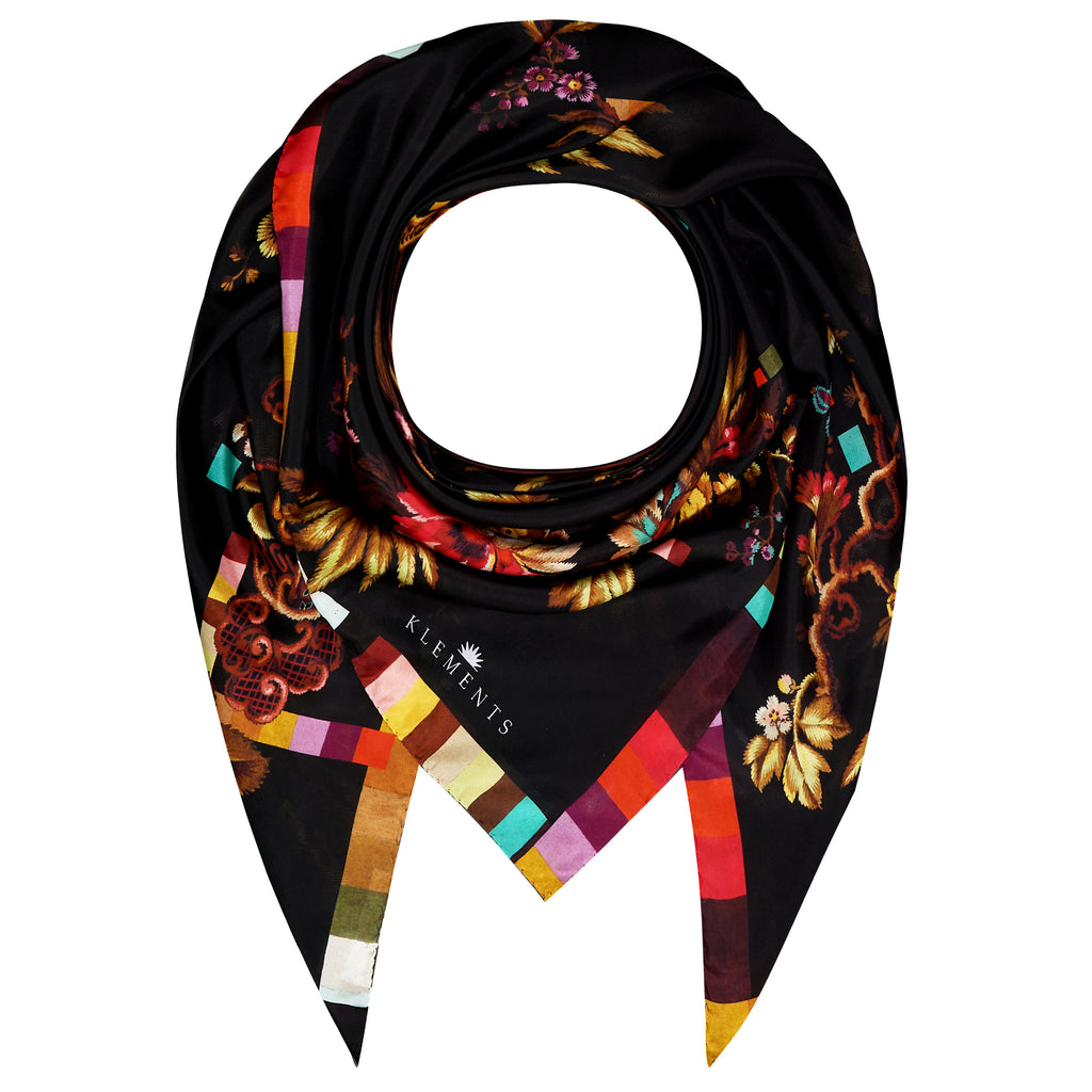 100% silk scarf from Klements is patterned with florals and color reference chips in shades of red, pink, gold, purple and teal