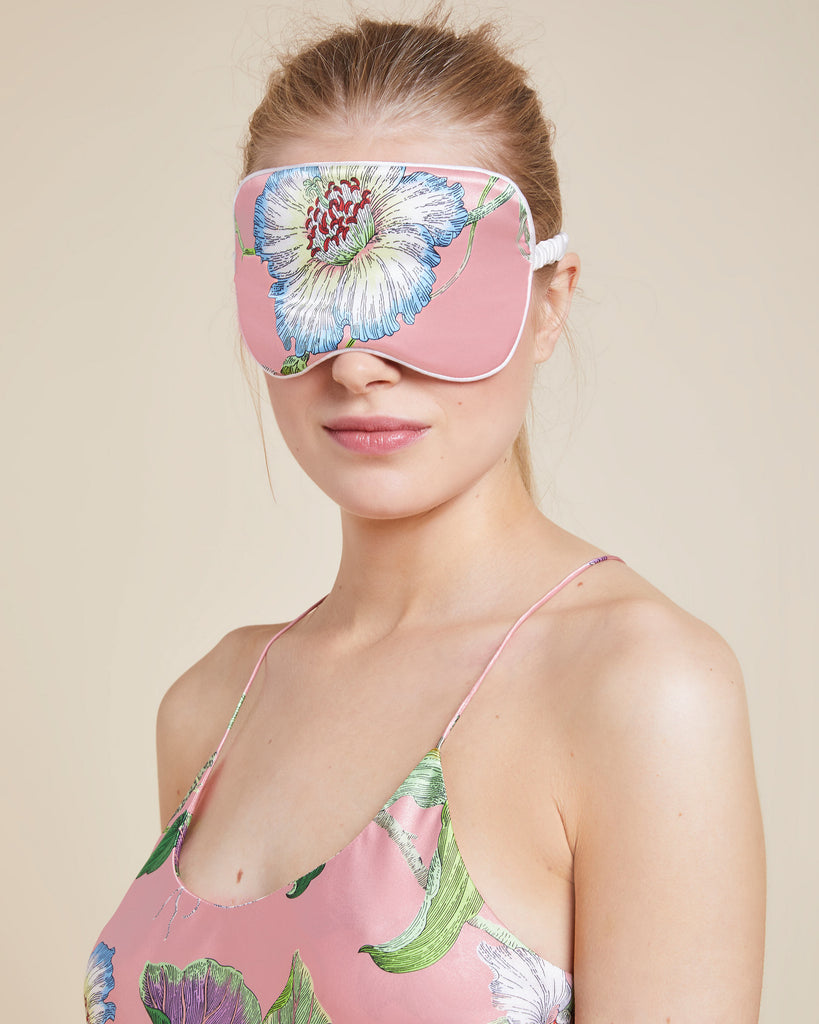 Classic eyemask from Olivia Von Halle is constructed from floral-patterned pink silk