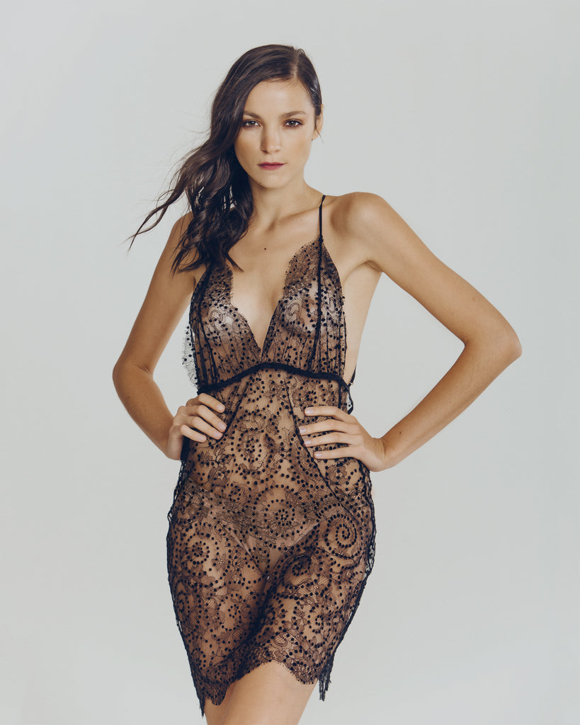Sheer black lace Gilda & Pearl slip is embellished with tiny black velvet polka dots