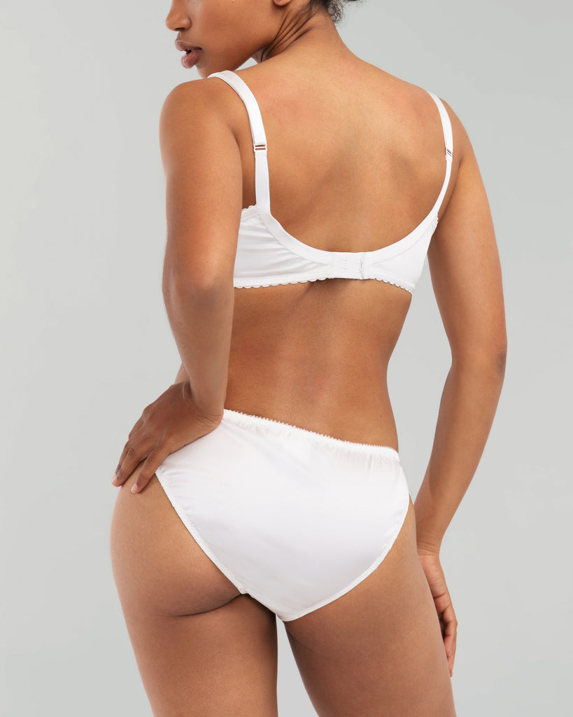Matching mid-rise bikini panty from Cadolle is crafted from ivory silk with an elasticized waistband