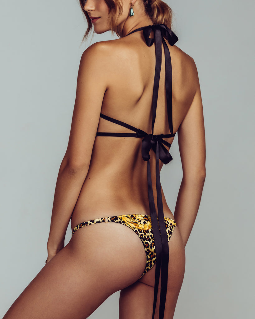 Cadolle's Porno Chic lingerie set is constructed from leopard print silk with gold scrolling details and black silk ribbons