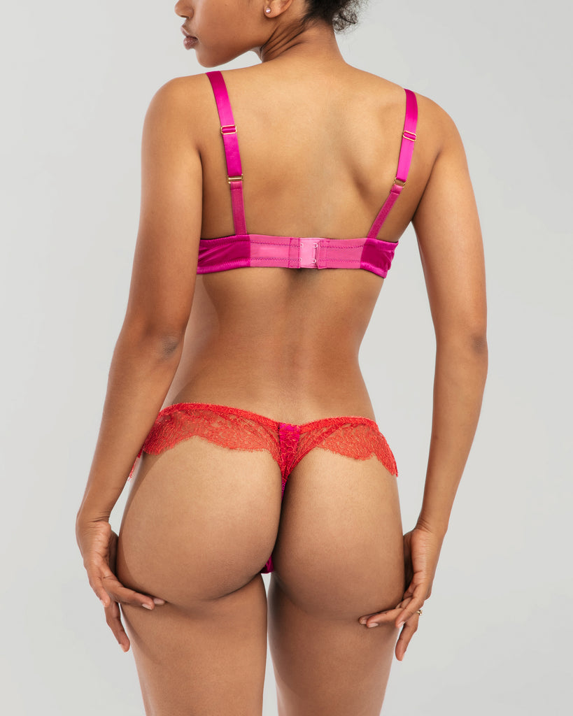 Matching Rama Sanguine thong panty has a cotton-lined silk front and gusset with sheer scalloped red lace sides
