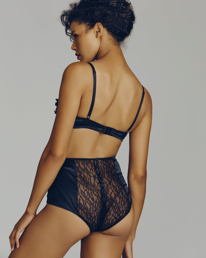 The rear of the panty from Camille Roucher uses silk-covered buttons to close the sheer lace rear, beautifully hugging every curve
