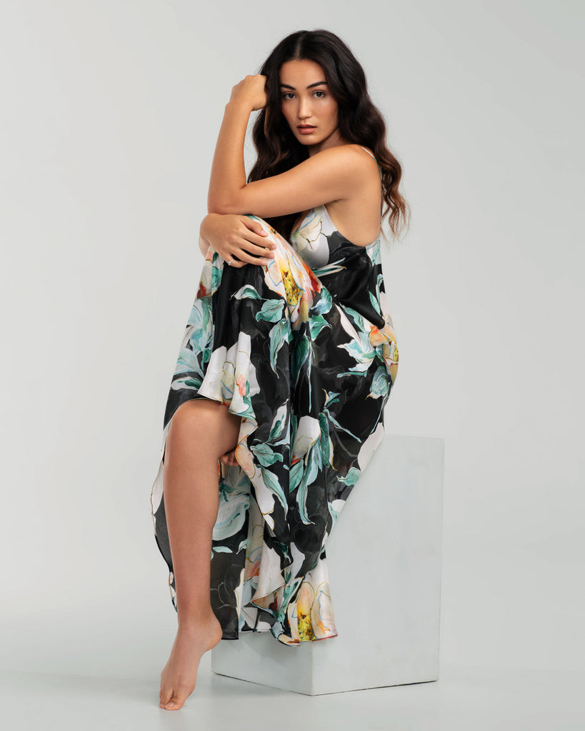 Christine Vancouver Ophelia silk gown is constructed of ultra lightweight black silk charmeuse with an oversized floral print in shades of white, yellow, orange, red and teal