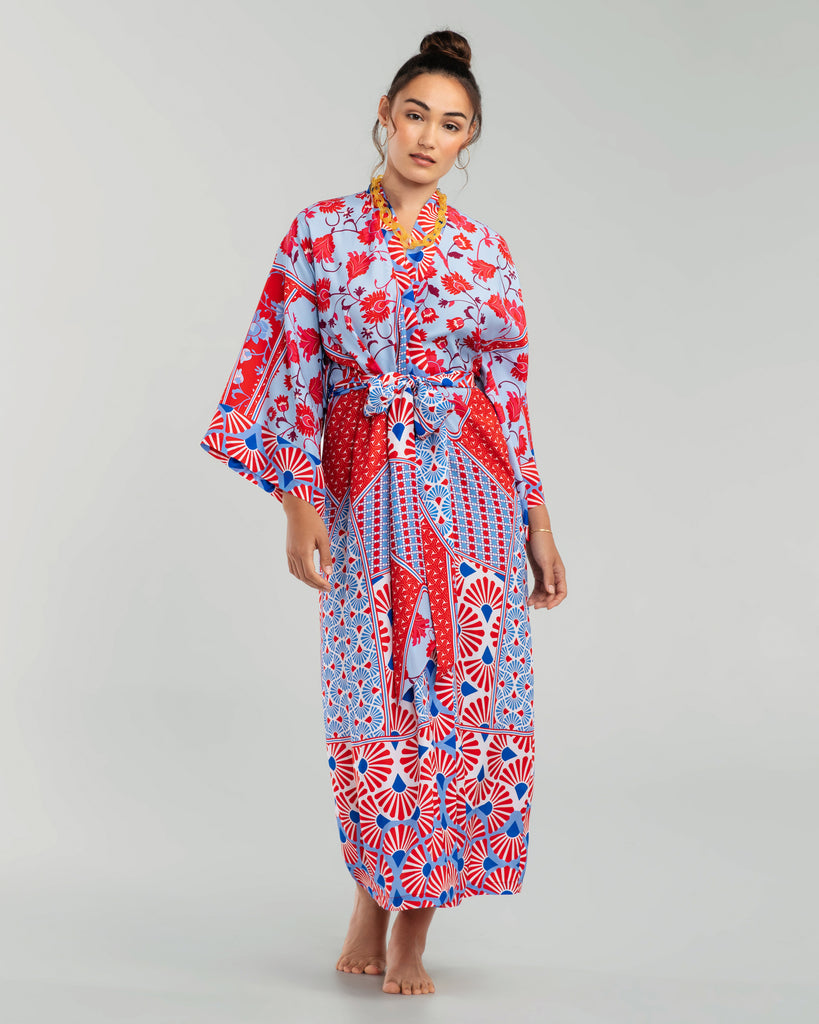 Christine Vancouver's Ophelia ankle length silk robe is crafted from silk crepe with a satin finish with a geometric pattern in shades of red, white, and seaside blue