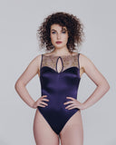 Bateau neckline on Coco de Mer's Golden Heron Bodysuit is entirely embroidered tulle with silk-edged keyholes at the front and rear