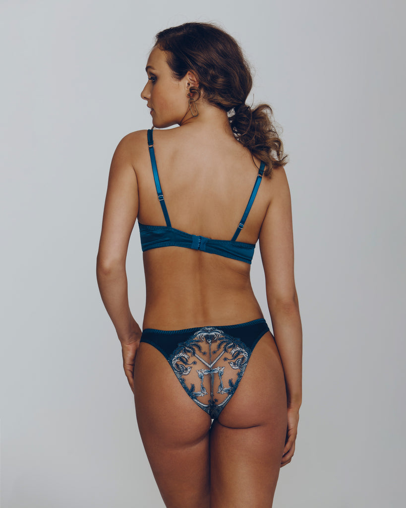 Coco de Mer Lovers Palm tanga has high-cut legs and a sheer embroidered rear