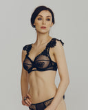 Seductive cage bra is constructed of black elastic with Swarovski crystal embellished lace at the shoulders