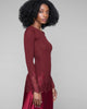Long sleeved top from Dana Pisarra is crafted of burgundy red ribbed knit silk, ultra stretchy and comfortable